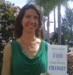 "Leah Oviedo with her book, ""How Will You Create Positive Change"""